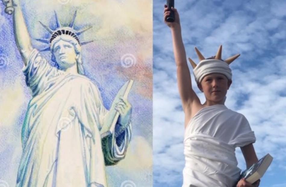 Land of the free . . . Alex Smith (10) at home in Dunedin, recreates the Statue of Liberty for...