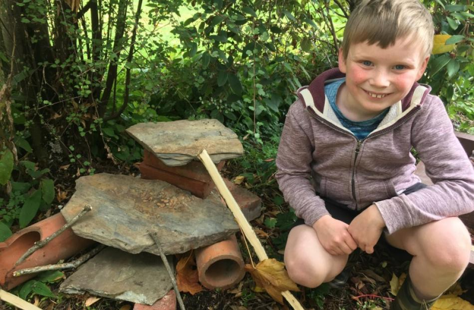 Lizard lounge . . . Noah Leitch (8) with a habitat for lizards he built in his Roslyn back yard....