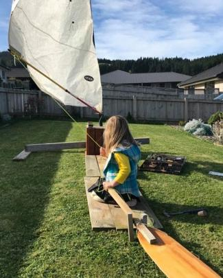 Like Moana . . . Ella Kirkland sets sail in her Sawyers Bay back yard, emulating her favourite...