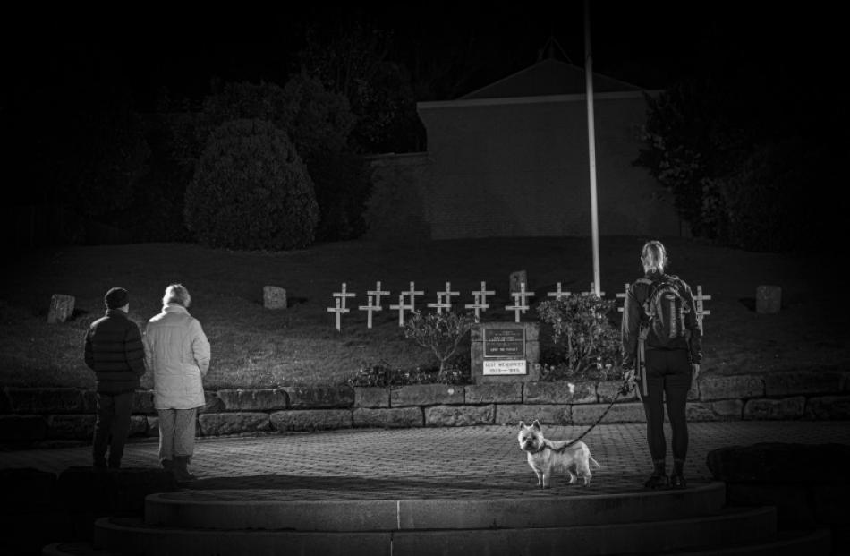 Remembrance ... Jo Thompson with dog Molly and two other members of the public at the Port...