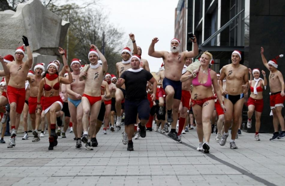 People take part in a half-naked Santa run in Budapest, Hungary. REUTERS/Laszlo Balogh