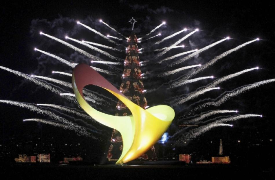 The logo of the Rio 2016 Paralympic Games is seen in front of a fireworks display around a...