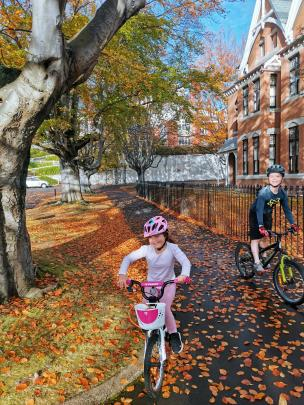 Jessica (5) and Jake (7) Lucas, of Dunedin, cycle around the University of Otago. PHOTO: TIM LUCAS