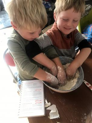 Toby (5) and Arthur (4) Kennedy get into some serious mixing to help with making their morning...