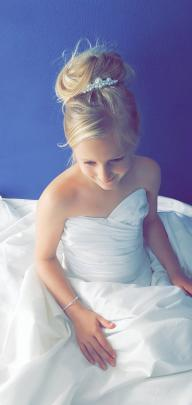 Jasmine Hamilton (9) plays dress ups with mum's wedding dress at home during  Lockdown 2020....