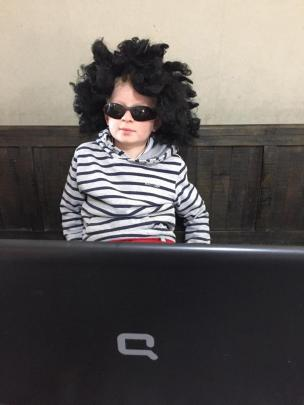 School's in . . . James Glover (8) is ready for his first online classroom lesson. Photo Mark Glover