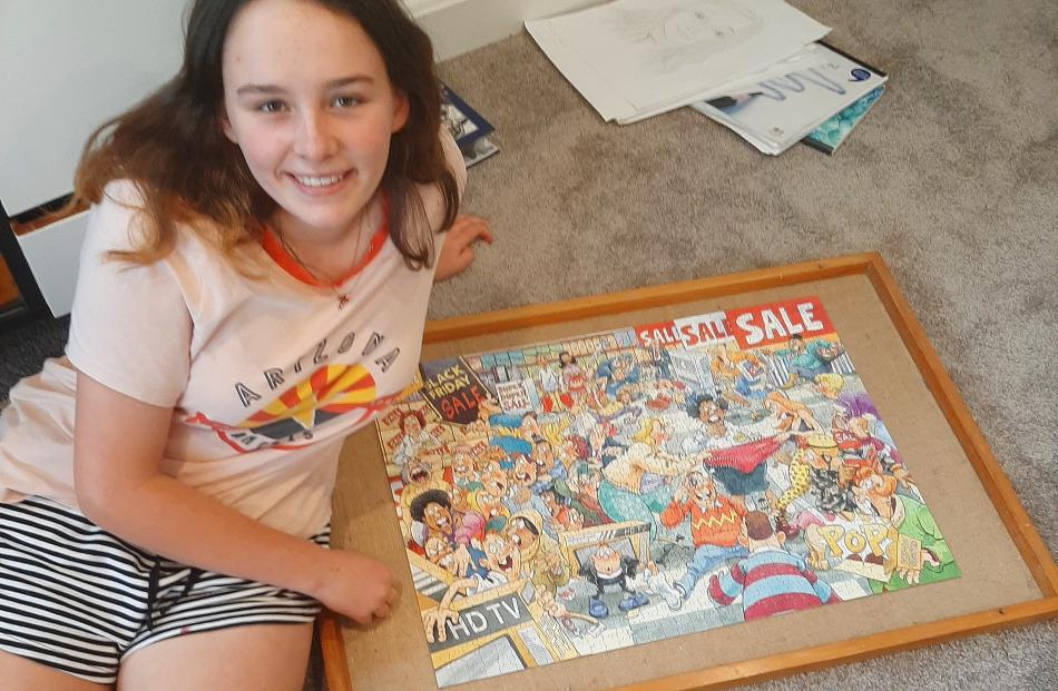 Marnie Brosnahan (14) working on a jigsaw at home in Roslyn. PHOTO: Sylvie Brosnahan