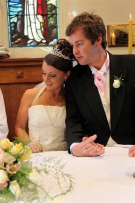 Lisa (nee Davies) and Hayden Cosgrove at their wedding in Queenstown last September.  The couple...
