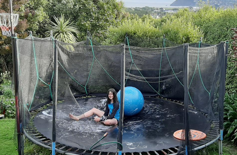 No viruses in here . . . Alice Anderson (13) makes the trampoline more challenging with the...
