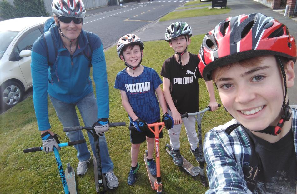 Taking a trip with Dad along Highcliff Rd on the scooters are ; (from left) Stuart Davis, Liam...