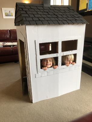 Olivia (6) and Samuel (3) Fleck, of Te Anau, play in the cardboard house they made from a...