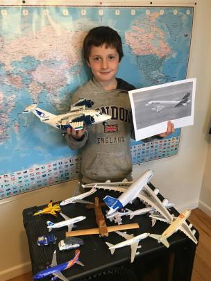 Sam Reeve (7), of Dunedin, with some of his planes and a picture of a LATAM plane. PHOTO:...