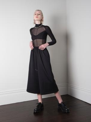 The Wide Leg Cullotte by ISBIM is a versatile back-to-work item pairing the comfort of an elastic...