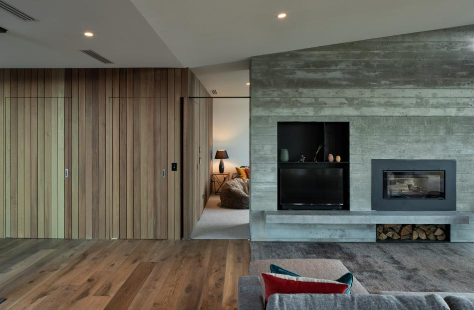 Cedar and board-formed concrete feature inside and out.