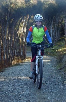 Tania Reid, of Lake Hawea, rides the popular Hawea River track from Albert Town to Lake Hawea.