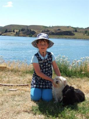 Jodie Kitchingman (8), of Dunedin, with Roxy and Nike, visits her grandparents who are regular...