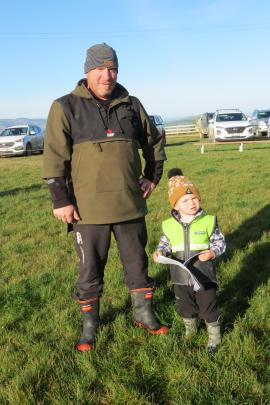Learning on the job ... Clay Clark (2) was excited to accompany his grandfather Cameron Clark, of...