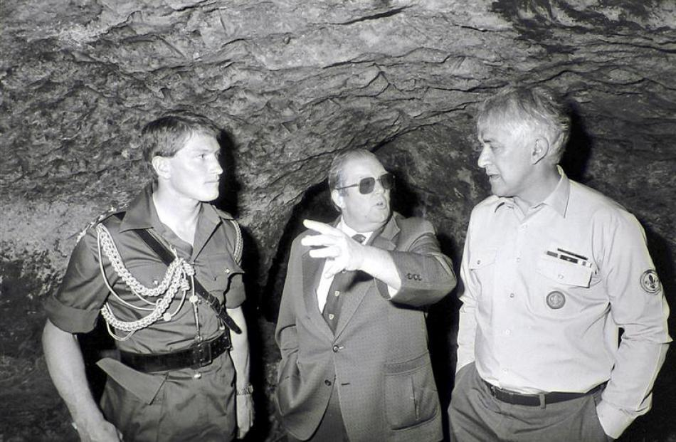 Former governor-general Sir Paul Reeves (right) inspects the chamber behind the Shore St door...