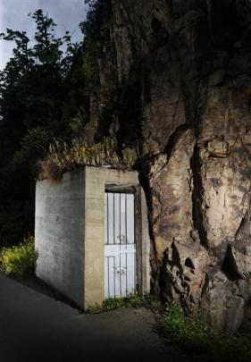 The door to a cave used for explosives storage more than a century ago, during the blasting of...