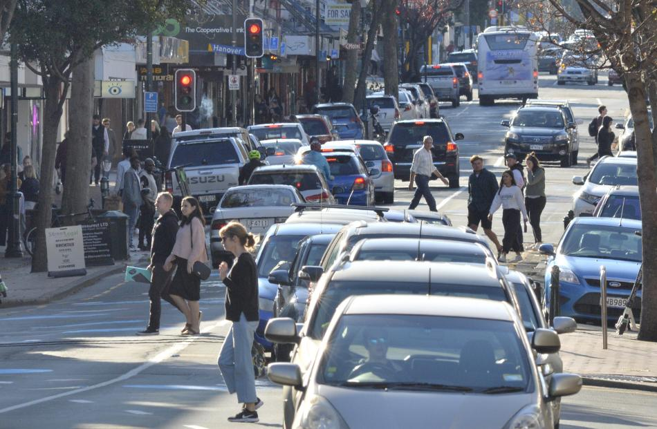 Vehicles and pedestrians mingle in the 10kmh area of George St in Dunedin on Saturday. PHOTOS:...
