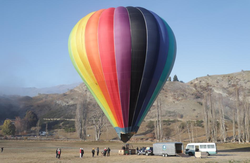 Sunrise Balloons prepares for the skies above the Wakatipu Basin yesterday. PHOTOS: HUGH COLLINS