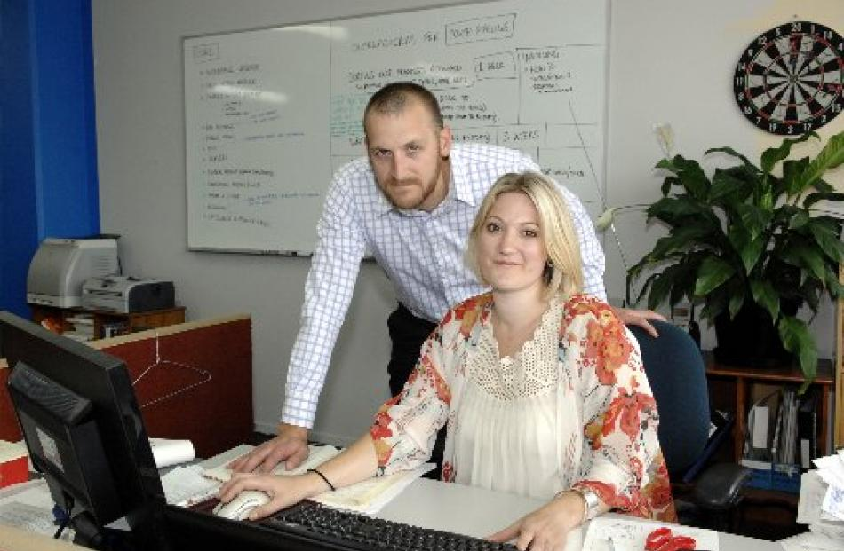 Outreach Software managing directors Richard Fyfe and Alix Lucas-Fyfe at work in their office in...