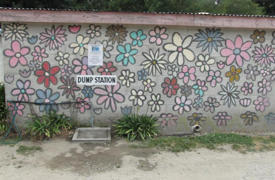 Painted flowers on the back of the dump station and laundry building.