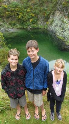 Hamish (11), Alex (14) and Grace Lamb (10), of Timaru, above the deep swimming pool at Danseys...