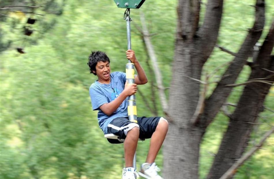 Wairongoa Bennett (14), of Otaio, enjoys a ride on the flying fox at the holiday park. Photo by...