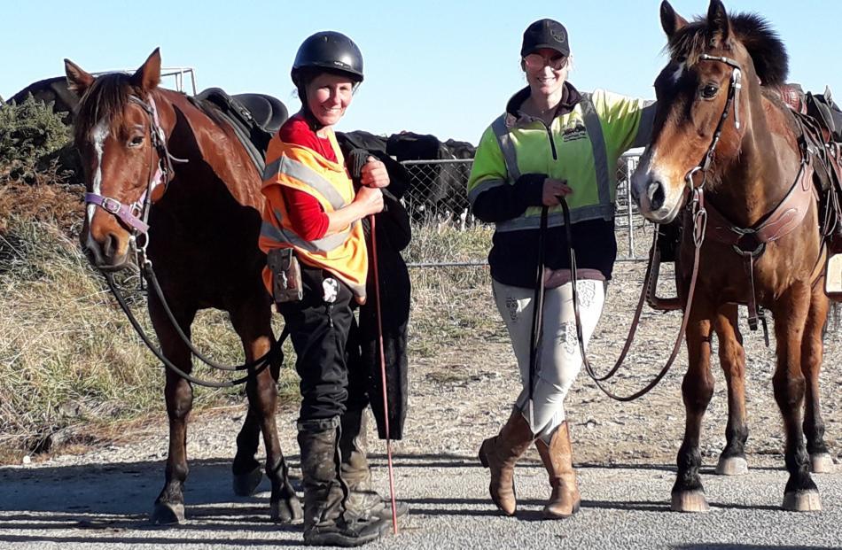 Taking a break ... Riders Megan Barclay (left) and Danika Tairua take a break after moving 500...
