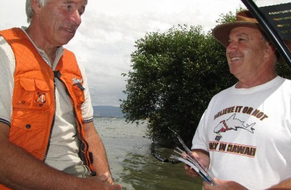 Part of Lake Dunstan harbourmaster Shayne Hitchcock's (left) job is to educate lake users on...