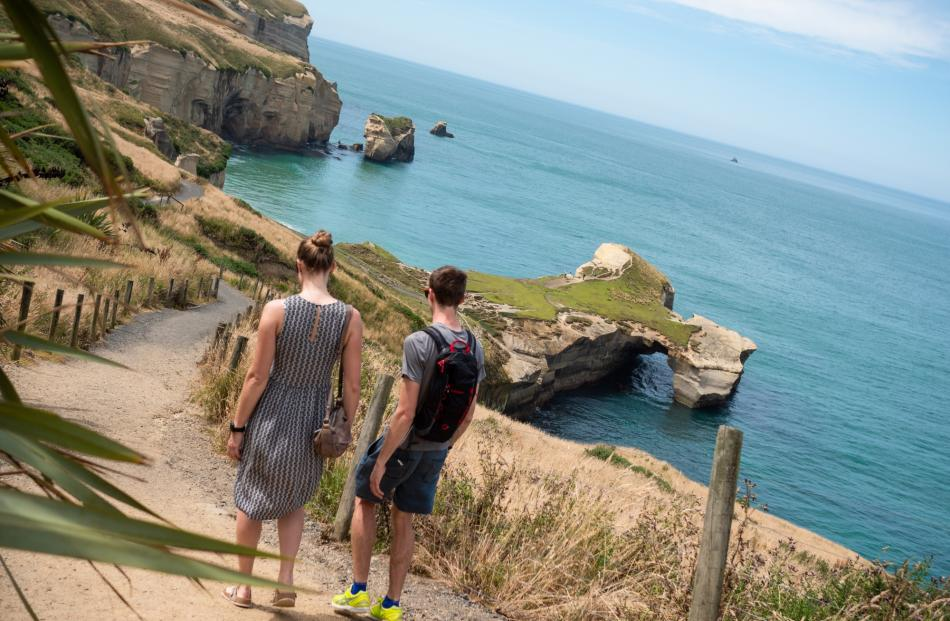 Tunnel Beach, accessed via a short walking track, offers breathtaking scenery.