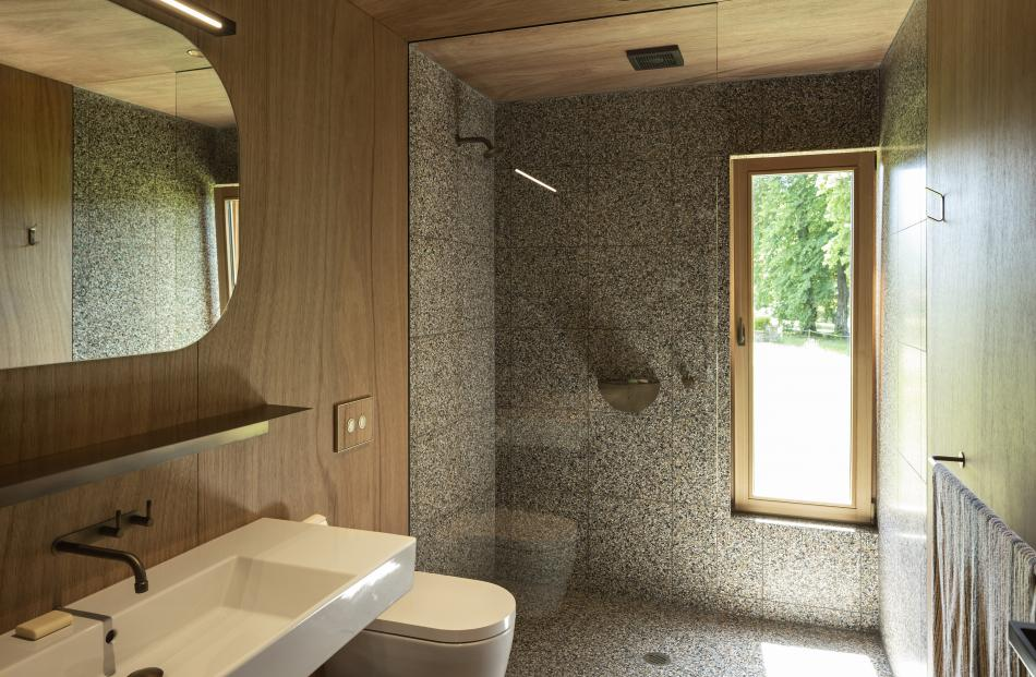 Terrazzo features in the two bathrooms.
