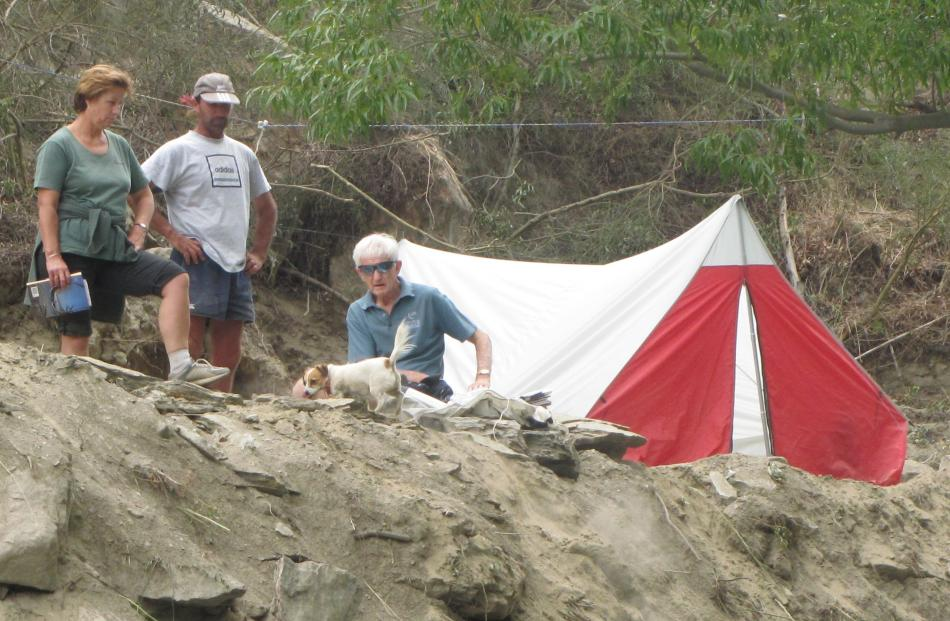 """Leigh Johnston (left), Malcolm McGregor and Allan Johnston with dog Tammy at """"camp"""" in  the..."""