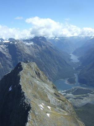 A hawks-eye view of Milford Sound, with its airstrip tucked away on the valley floor.