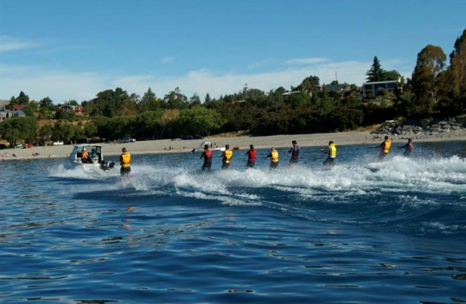 """A group of Balclutha water-skiers gets """"nine up"""" behind a boat driven by Ian Sinclair at Lake..."""