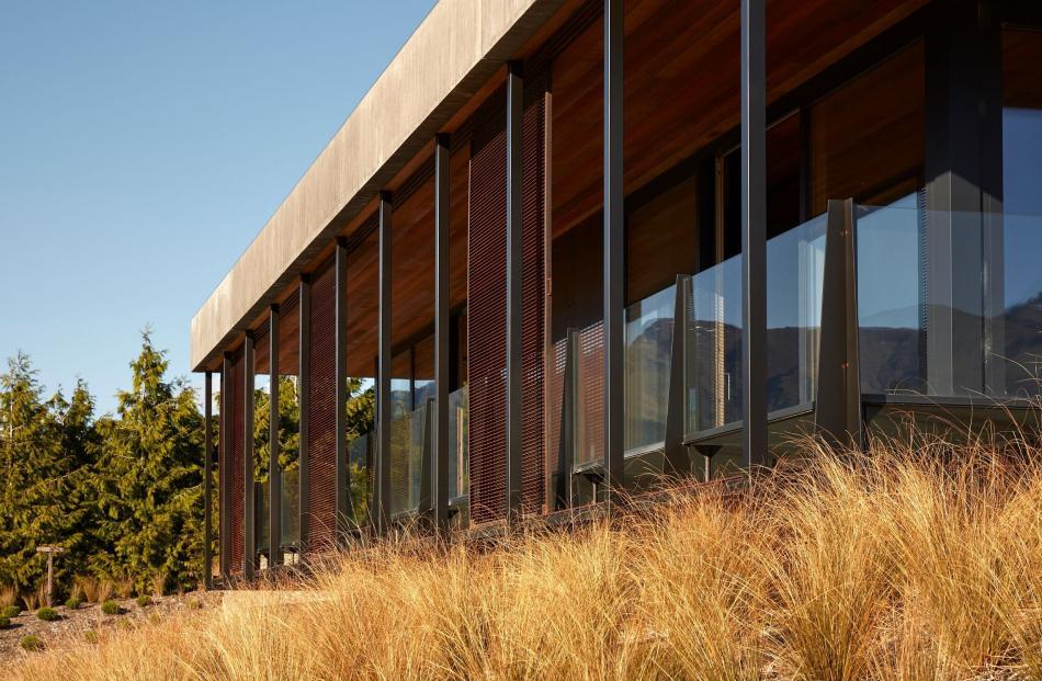 Mesh sliding screens on the veranda filter harsh summer sunlight entering the living areas.
