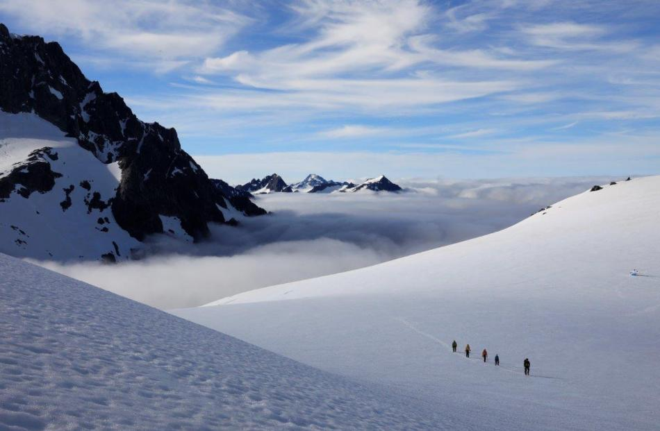 New Zeal owner Paul Nicolson guiding clients to a remote glacier.