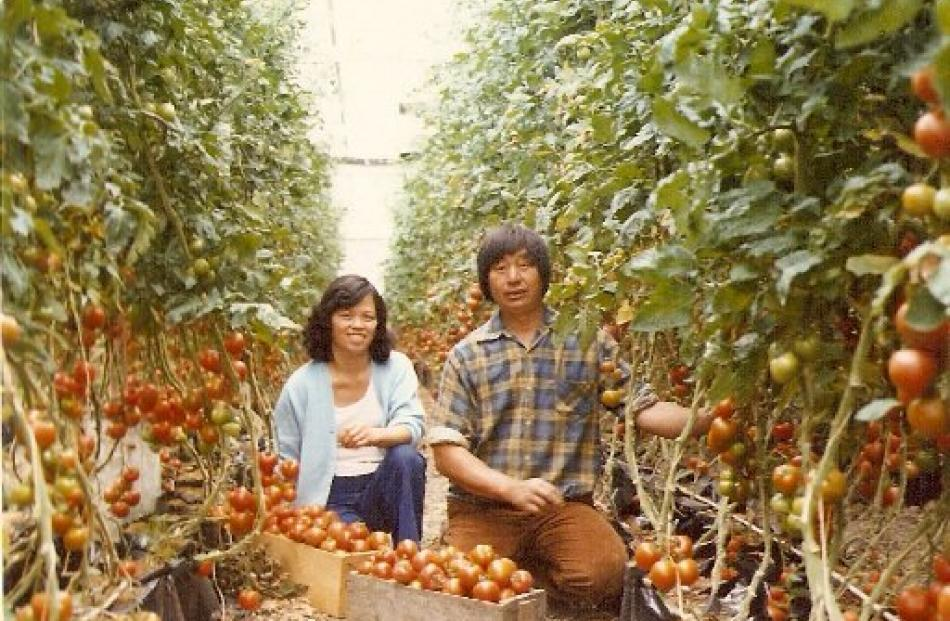 Suzie and Reggie Joe among their tomatoes, then grown in sawdust, in 1981.