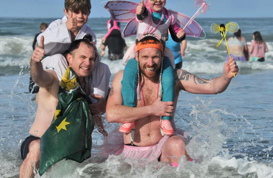 Bringing their children along for the polar experience are Darren Freeman holding Charlie (8) and...