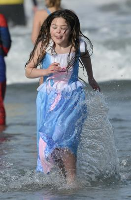 Lucielle Downing (6) leaves the water dressed as Cinderella.
