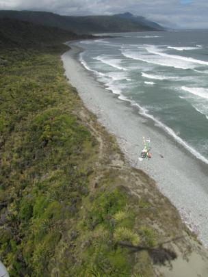 Greenstone Helicopters on South Westland beach between Gorge River and Barn Bay.