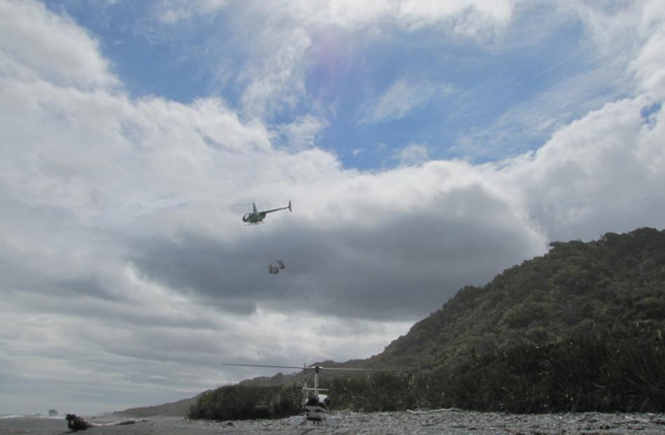 Greenstone Helicopters aircraft carries fadges of rubbish.