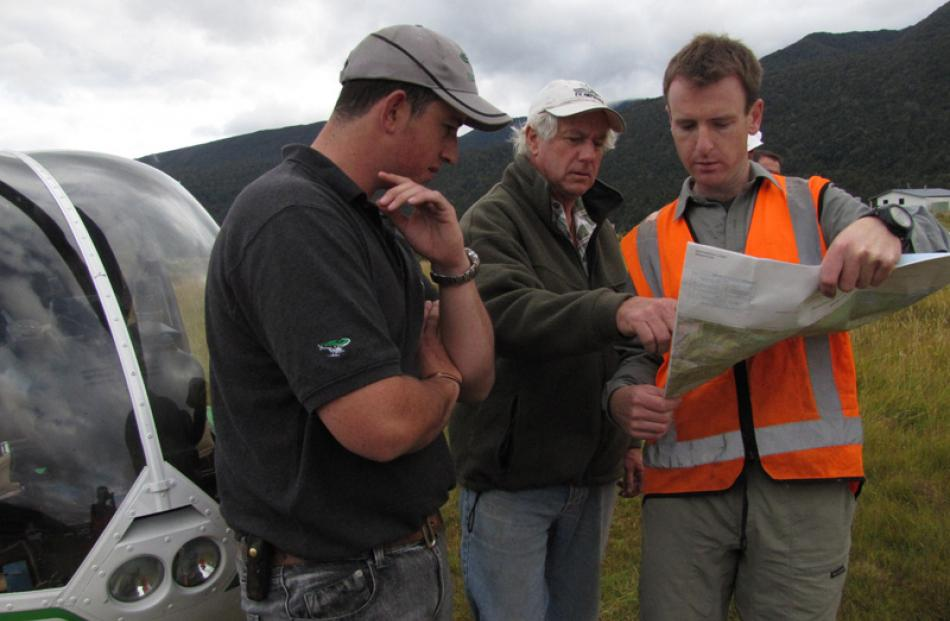 Pilots Peter Spencer-Bower and Geoff Robson discuss routes with Julian Tovey.