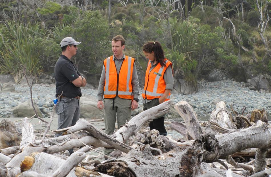 Pilot Peter Spencer-Bower, and Doc workers Julian Tovey and Lisa Mills at Gorge River.