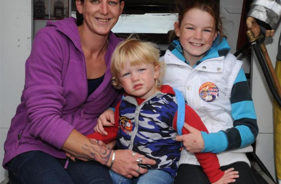 Susan, Quinn (2) and Jaymie (10) Cooper, of Dunedin at the Wings and Wheels show in Taieri...