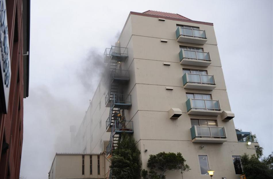 Smoke pours from the hotel. Photos by Stephen Jaquiery