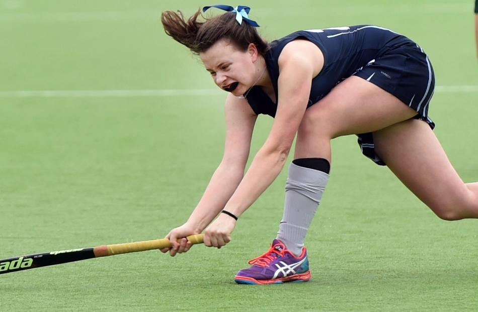 St Hilda's Collegiate player Ella Booth gets down low to hit the ball at the Mcmillan Centre...