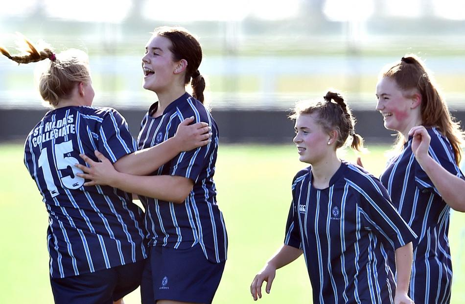 St Hilda's Collegiate football players (from left): Bee Park (17), Summer Cooper (15), Hannah...