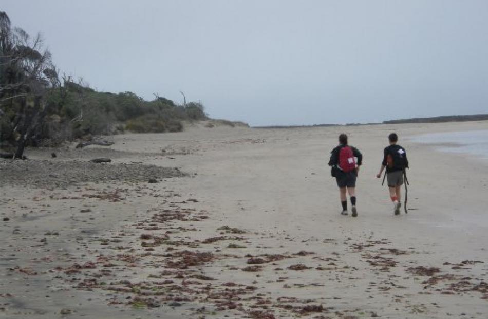 Megan Somerville (left) and Beth Romeril cross one of the beaches on the last leg of the Hump Track.